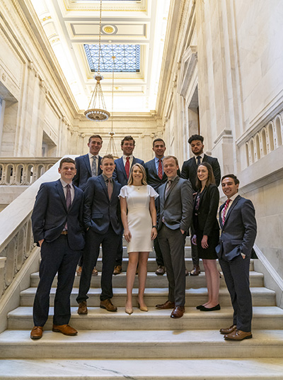 Senator Hawley interns posing on a staircase